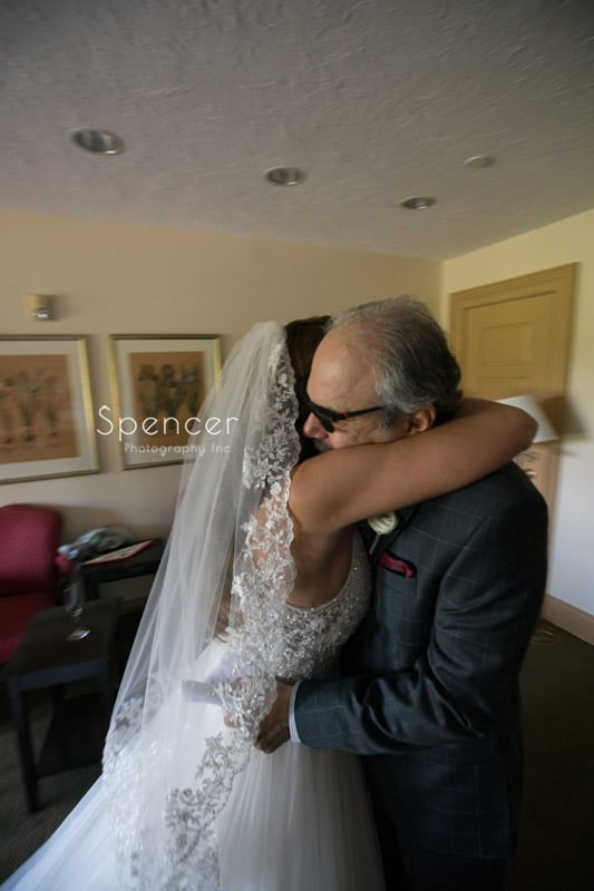 bride hugs father in bridal suite of Portage Country Club