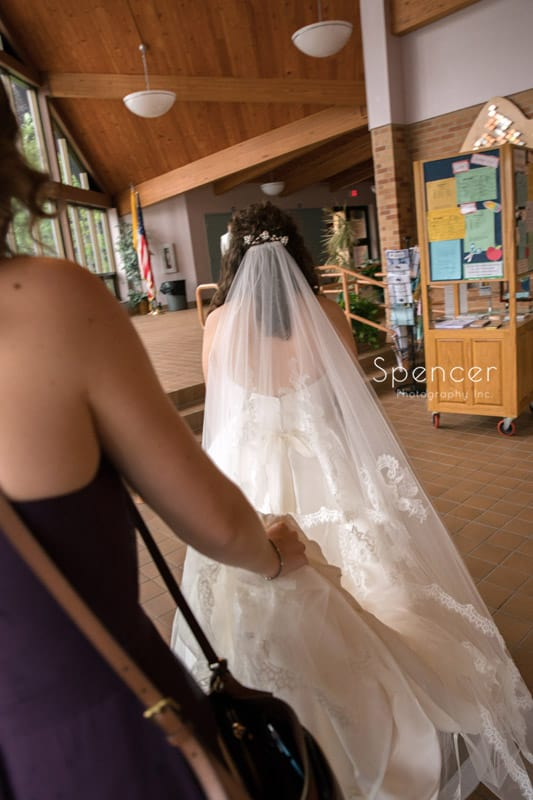 bride walking to wedding ceremony in akron