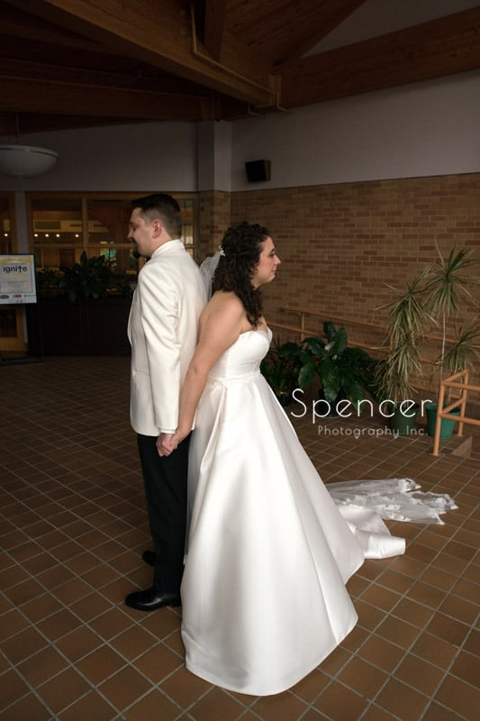 bride and groom during first look at akron wedding