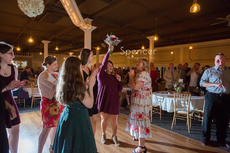 wedding guest catches bridal bouquet