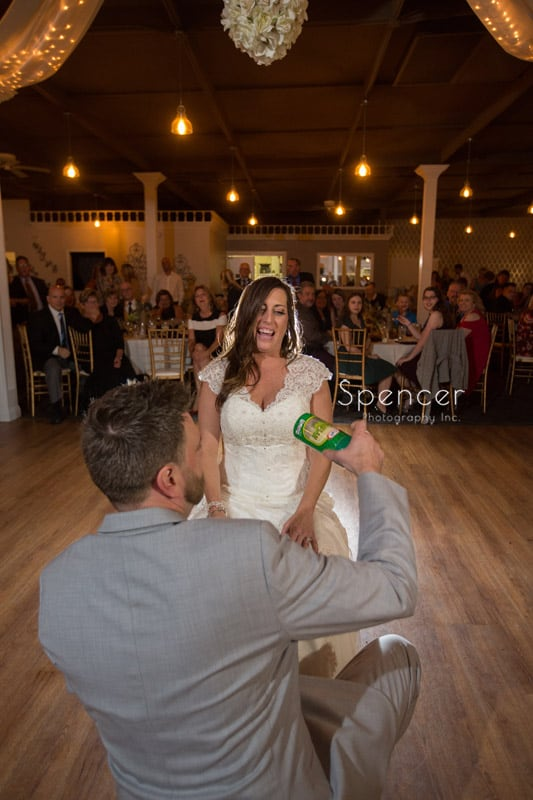 groom removing brides garter at Occasions Party Center