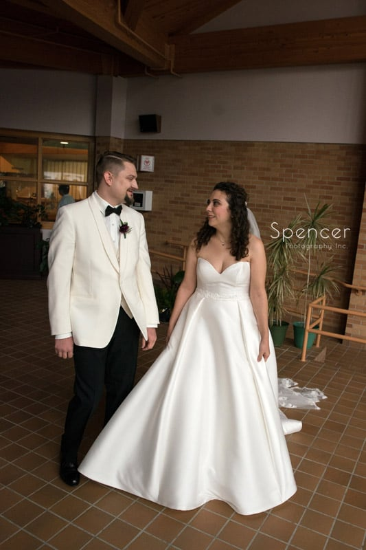 bride and groom seeing each other before akron wedding