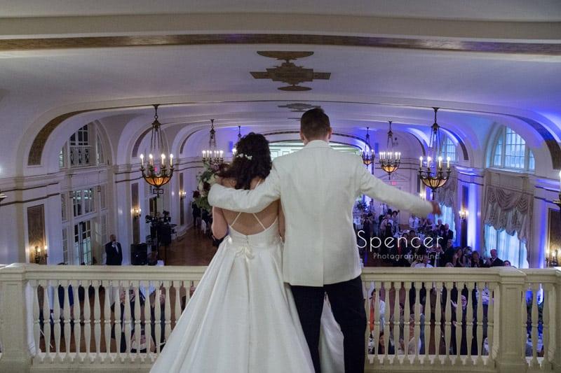 bride and groom enter their wedding receptio at Greystone Hall