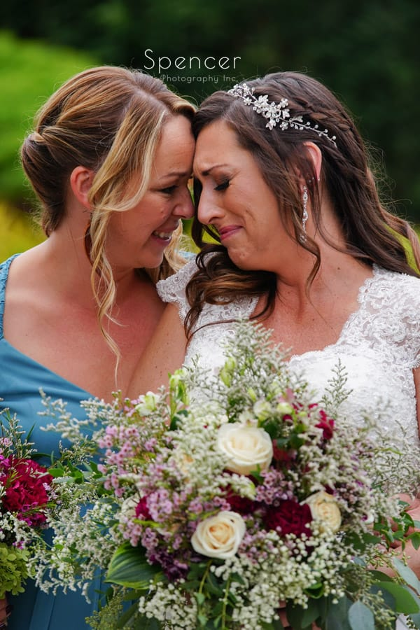 bride gets emotional during wedding pictures at Occasions Party Center