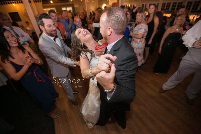 bride having fun at her akron wedding reception