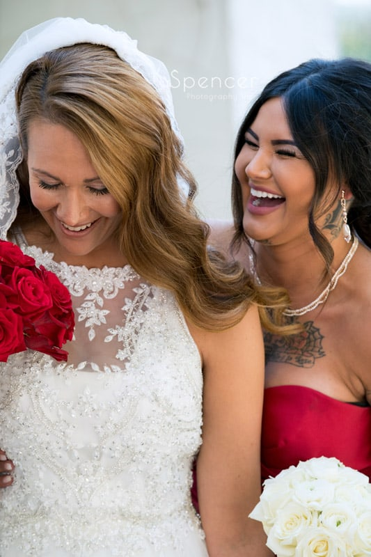 bride laughing with maid of honor at Portage Country Club