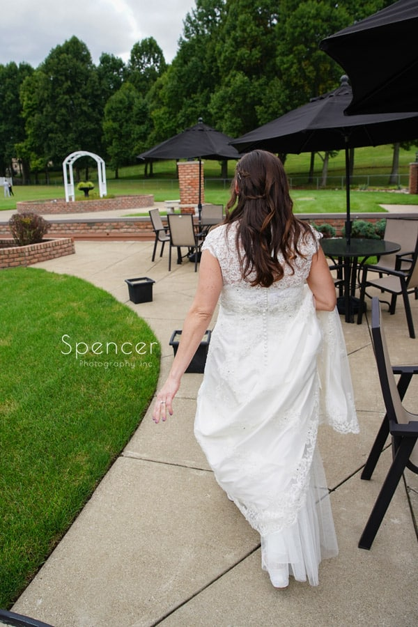 bride walking to meet groom on wedding day at Occasions Party Center