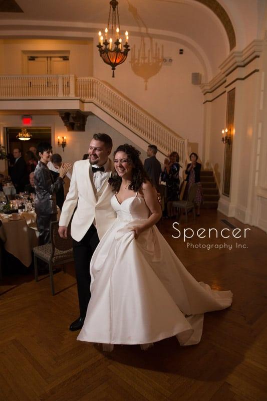 groom and bride enter their wedding reception at Greystone Hall