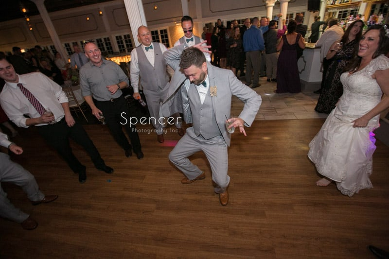 groom dancing at his wedding reception at Occasions