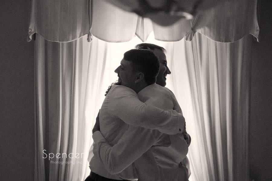 best man hugs groom on his wedding day in akron