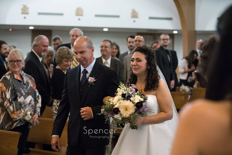 bride gets emotional walking down aisle