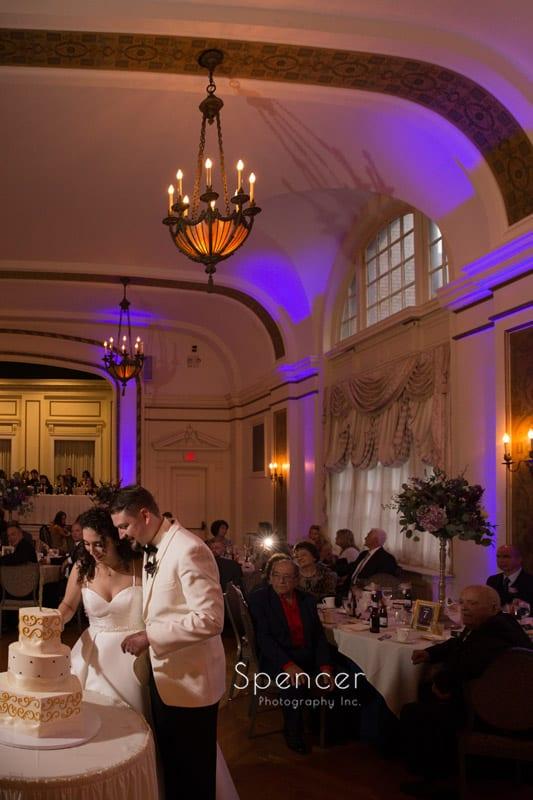 bride and groom cutting their wedding cake at Greystone Hall