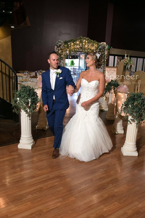 bride and groom enter their wedding reception at Antonelli Event Center