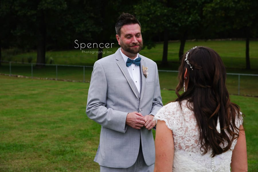 groom sees bride for first time on wedding day at Occasions
