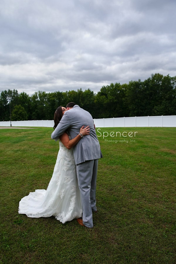 bride and groom hug on wedding day at Occasions Party Center