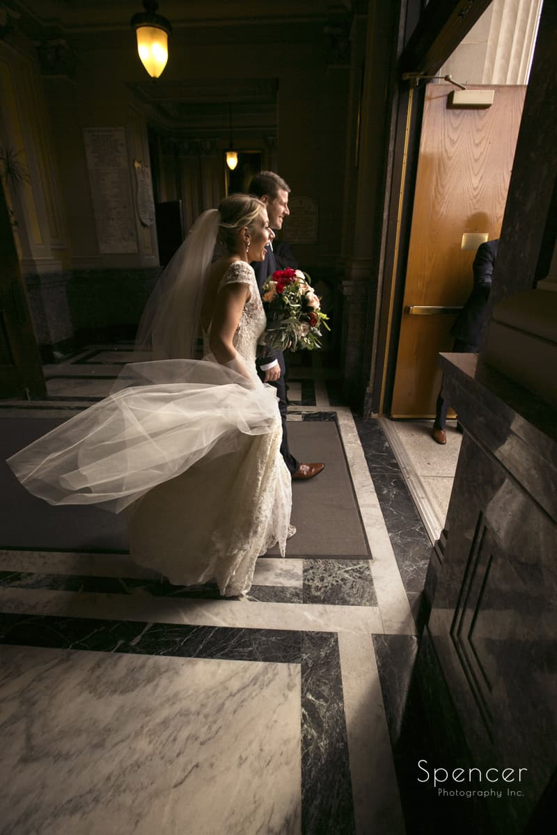 bride and groom leaving wedding ceremony at st colman cleveland