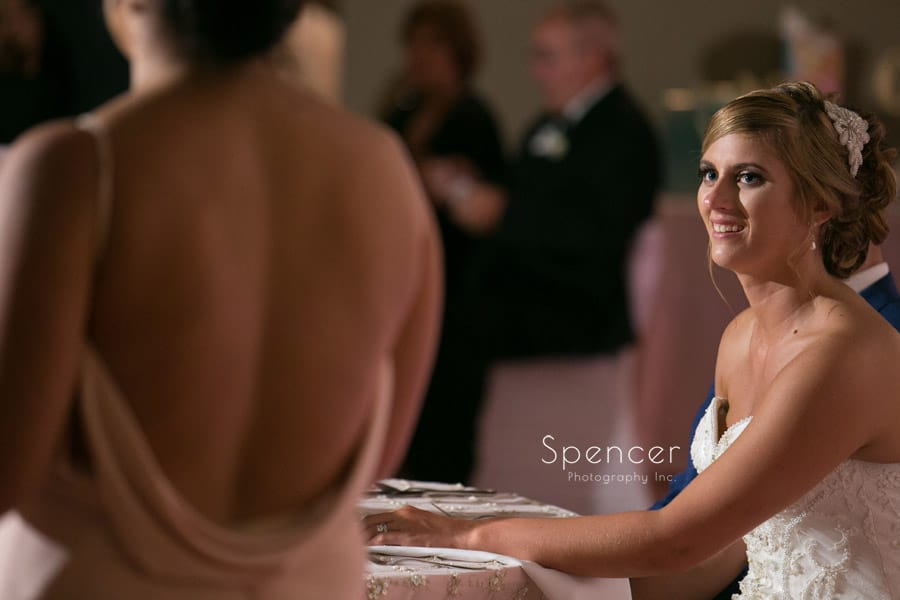 bride listeing to maid of honor speech at Antonelli Event Center reception
