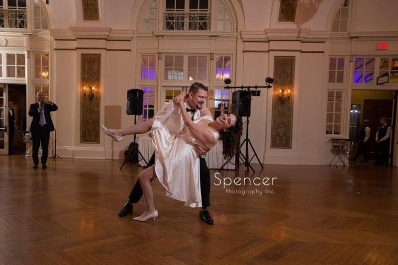 groom dips bride during first dance at Greystone Hall