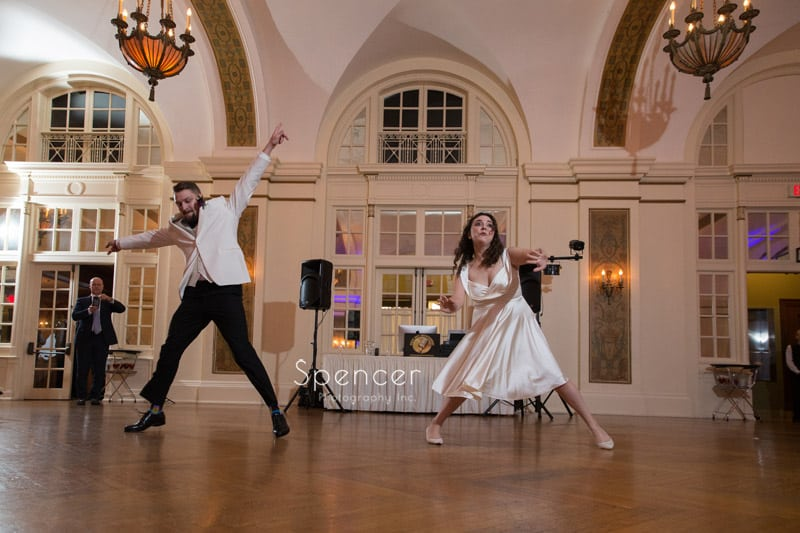 couple jump during first dance at Greystone Hall