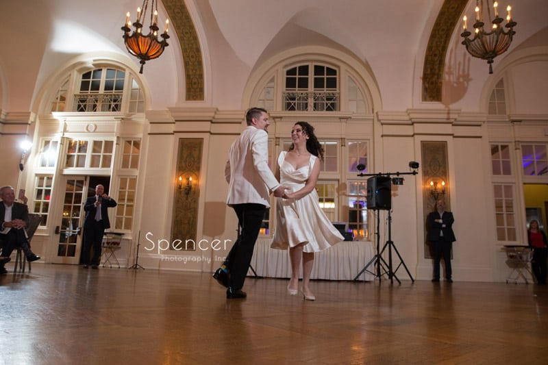 bride and groom twirl during wedding reception dance at Greystone Akron