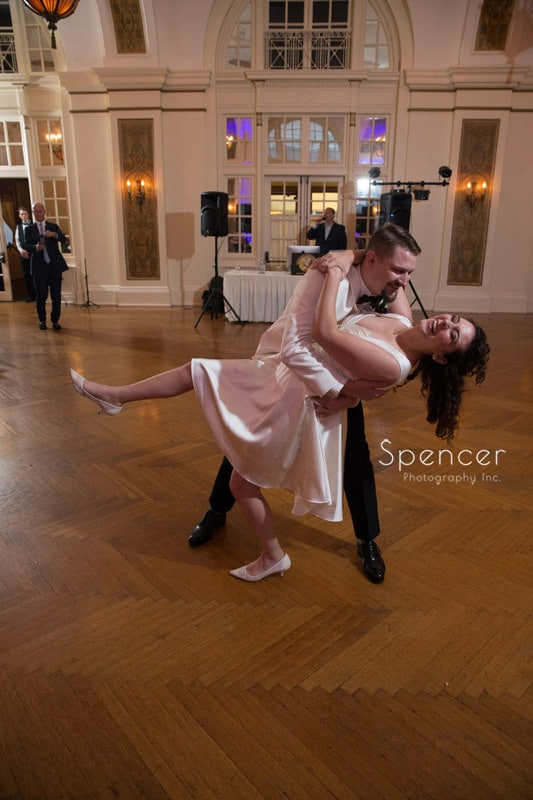 bride and groom dip during dance at Greystone Hall wedding reception