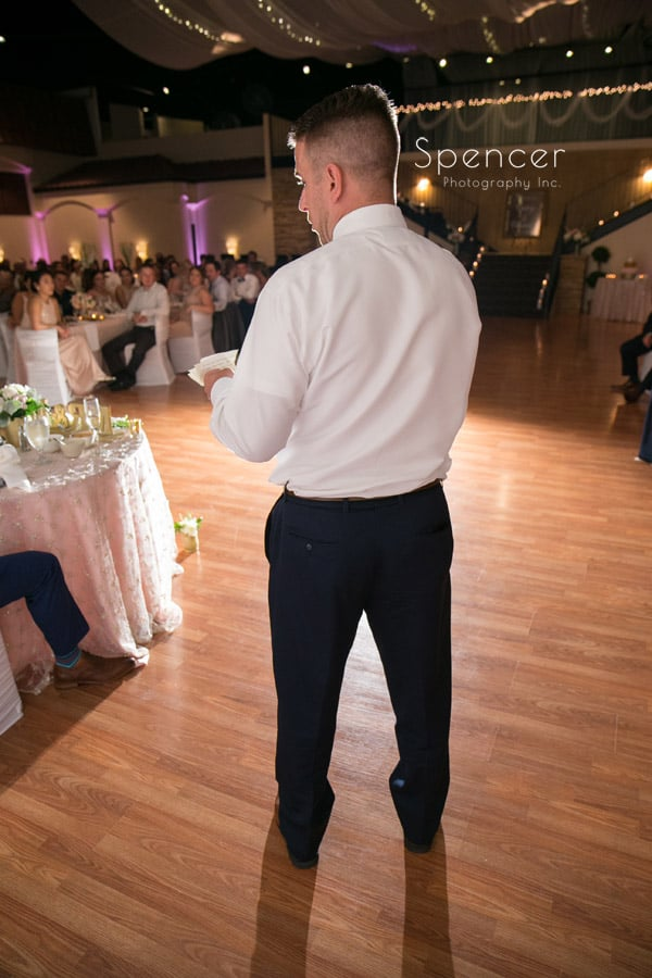 vertical picture of groomsmen speech at Antonelli Event Center reception
