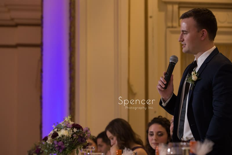 best man giving speech at wedding reception at Greystone Hall