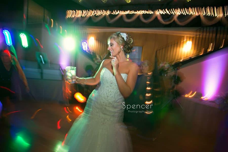 bride dancing at her wedding reception at Antonelli