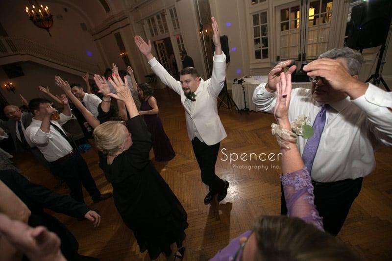 groom dancing at his wedding reception at Greystone Hall Akonr
