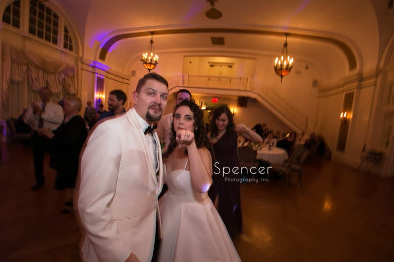 bride and groom at their greystone hall wedding reception