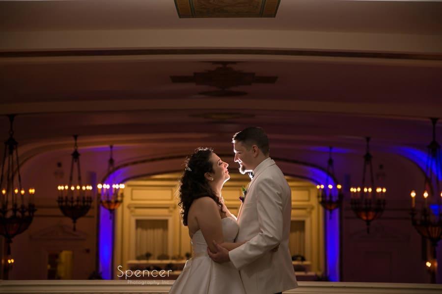 couple hugging at wedding receptionat Greystone Hall Akron