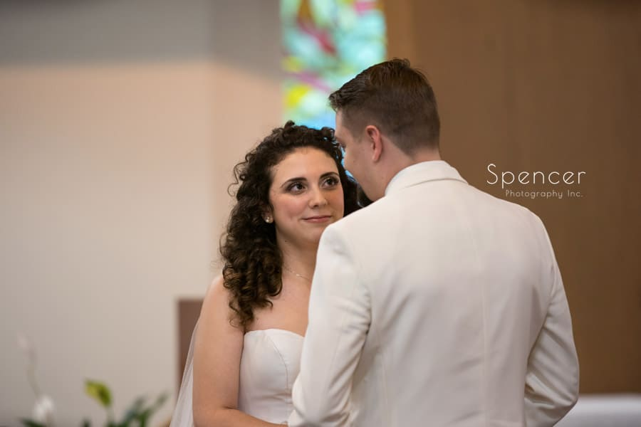 bride looks at groom during akron wedding