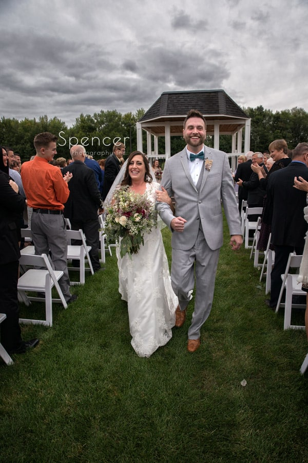 bride and groom exiting their wedding ceremony at Occasions Party Center
