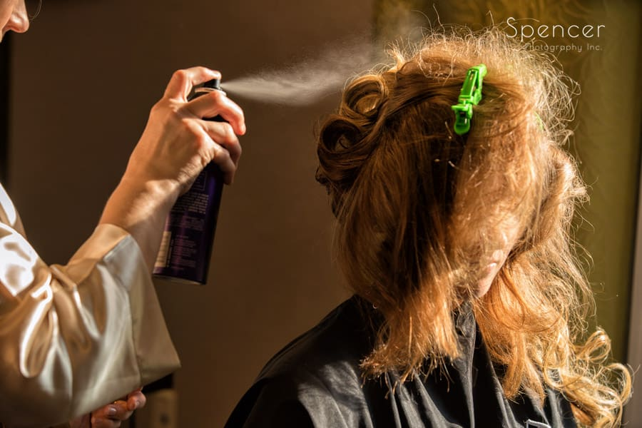 bride getting hair done on wedding day at Pittsburgh hotel