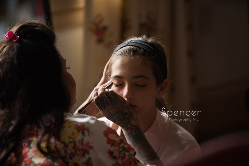 flower girl getting wedding day make-up