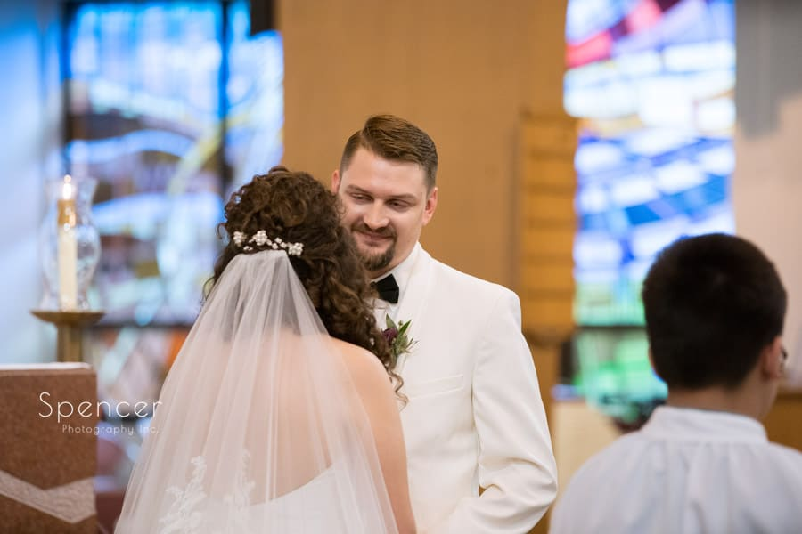 groom looks at bride during akron wedding