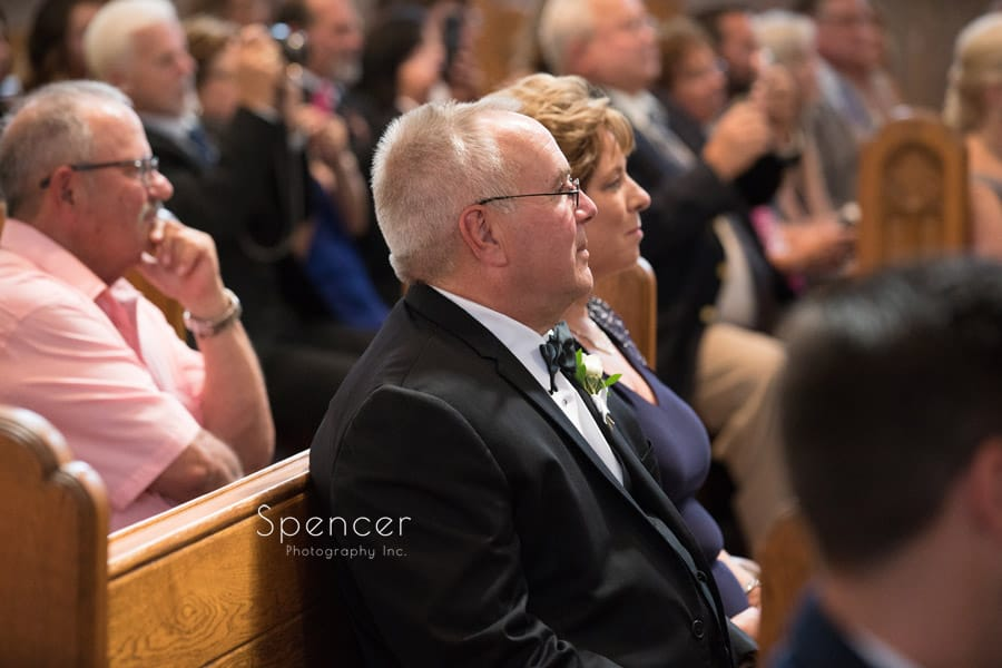 parent of groom watching wedding ceremony at St. Vincent Basilica