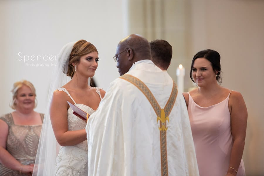 bride looking at groom during wedding ceremony at St. Vincent Basilica