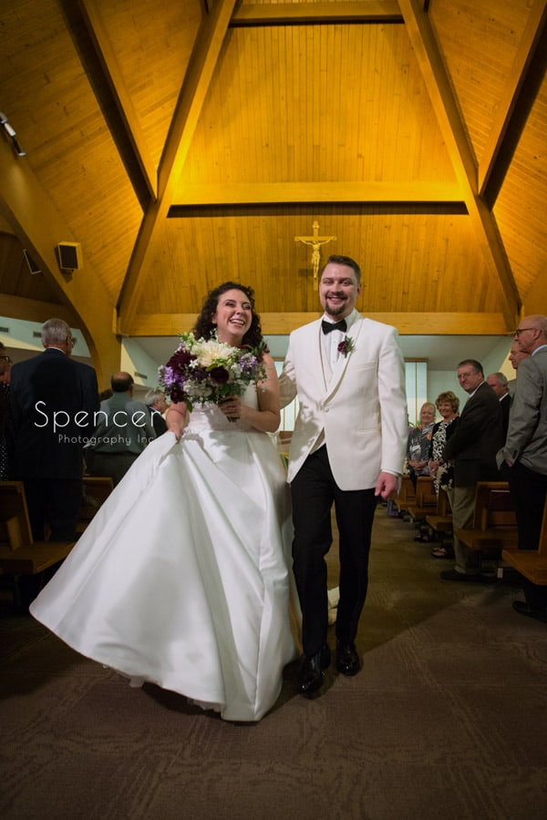 bride and groom during recessional at akron wedding