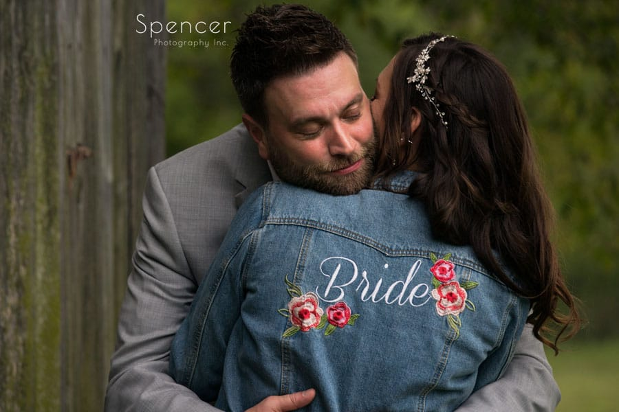 bride hugging groom at Occasions Party Center wedding