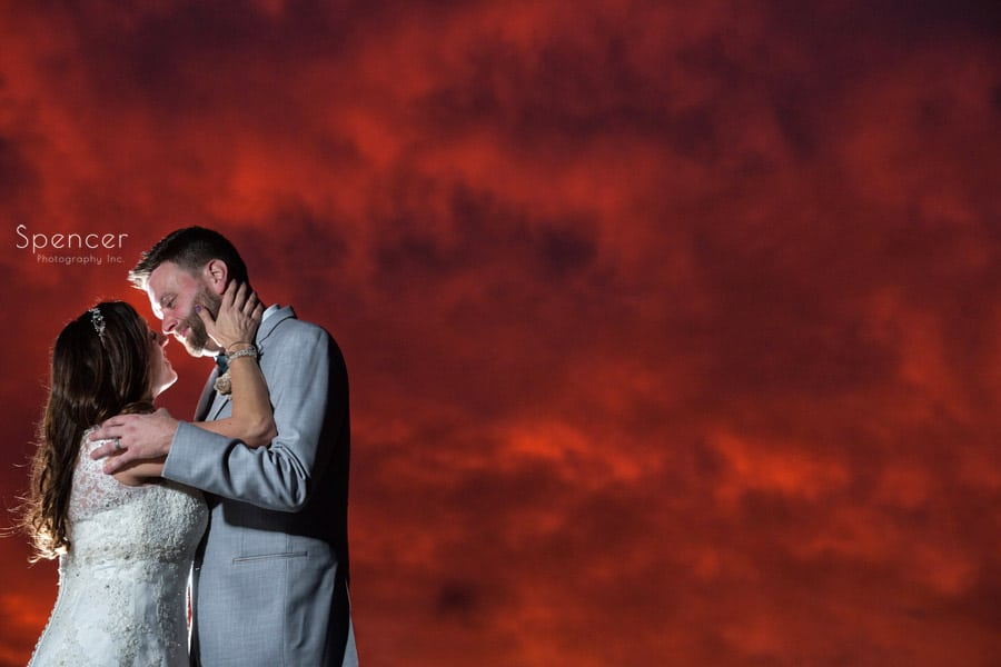 dramatic sunset wedding picture in akron