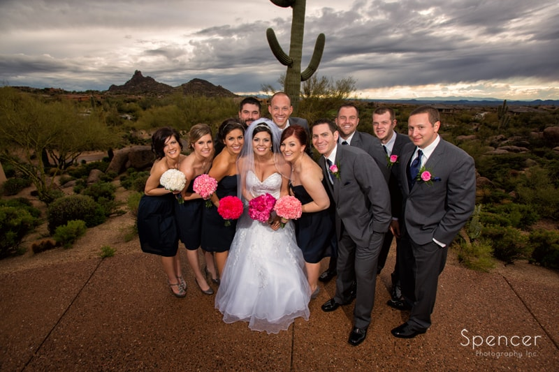 picture of the bridal party in desert during destination wedding