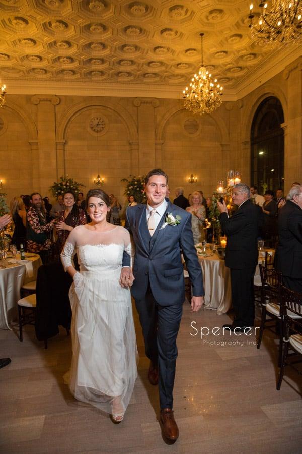 bride and groom entering wedding receptionat ariel pearl cleveland