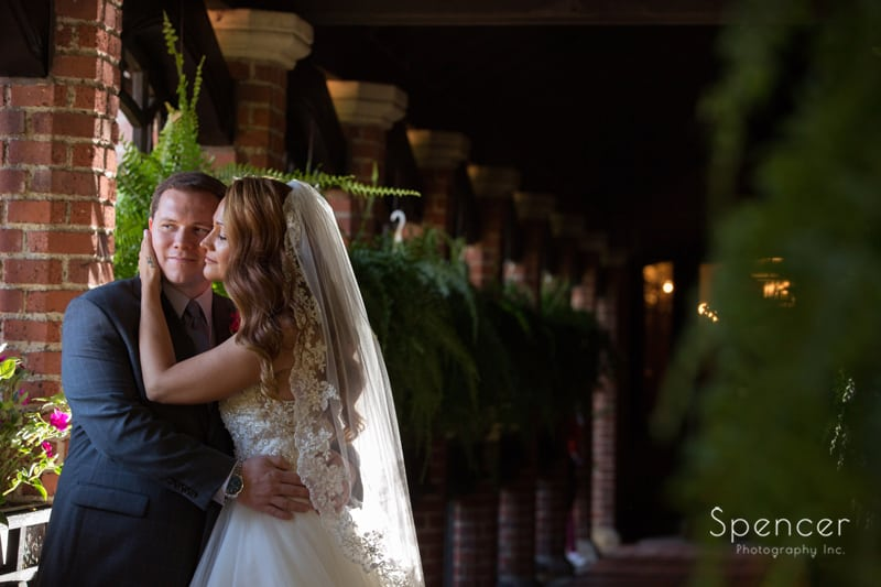 bride kissing groom after wedding at stan hywet