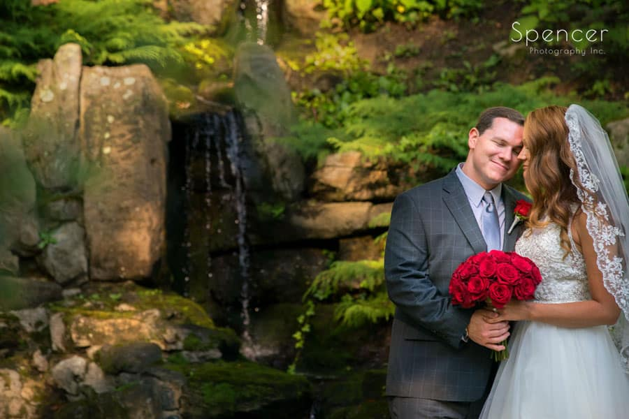 groom smiling with bride at stan hywet wedding