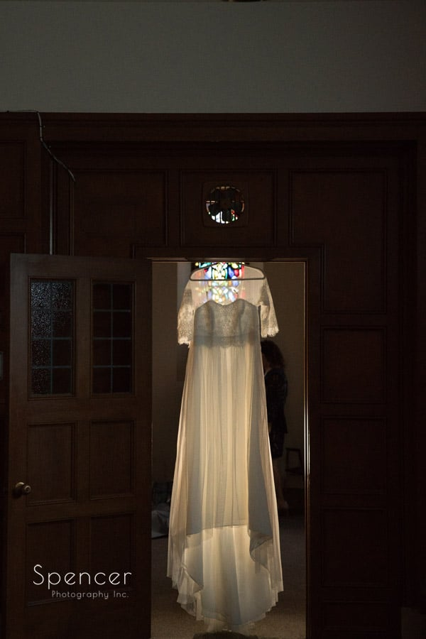 wedding dress hanging in St. Christopher Cleveland