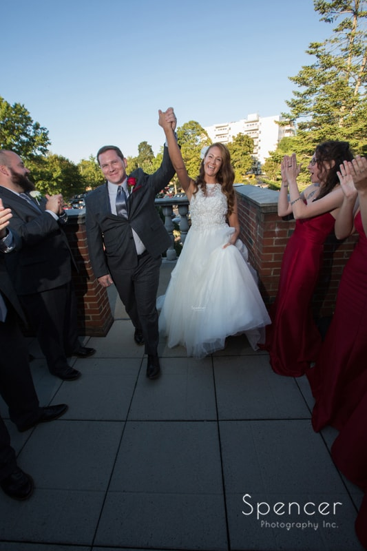 bride and groom celebrate their reception at portage country club