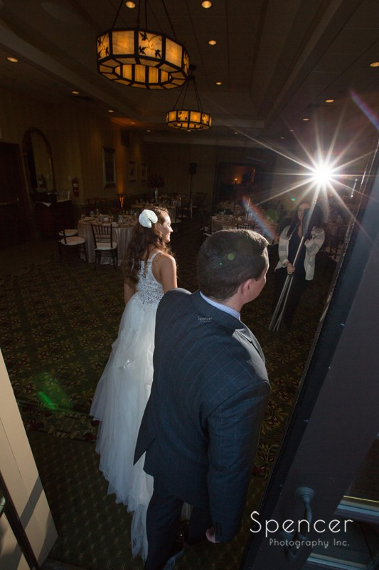 bride and groom enter their reception at portage country club