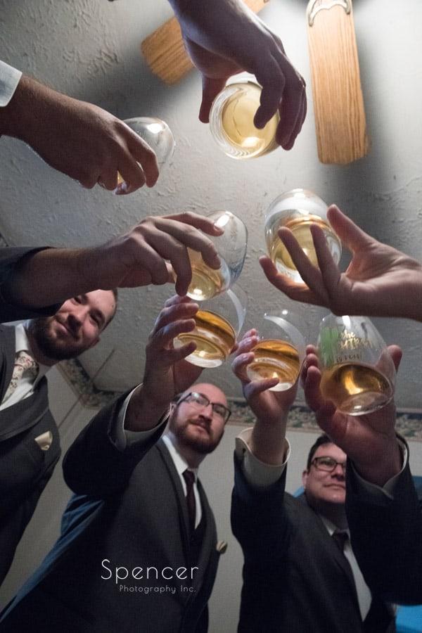 groomsmen having a wedding toast