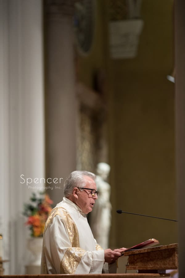 priest officiating wedding ceremony at St Joseph Church